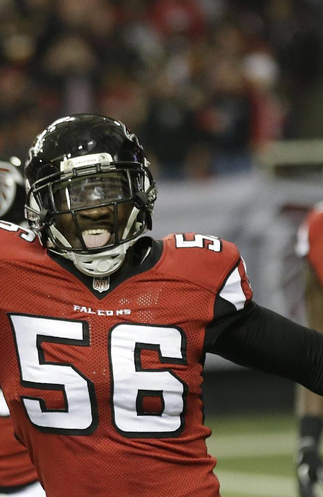 Atlanta Falcons outside linebacker Sean Weatherspoon (56) celebrates a Washington Redskins fumble during the first half of an NFL football game, Sunday, Dec. 15, 2013, in Atlanta