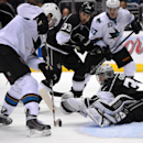 San Jose Sharks center Tomas Hertl, left, of the Czech Republic, scores on Los Angeles Kings goalie Jonathan Quick, lower left, as defenseman Willie Mitchell, second from left, and center Tommy Wingels look on during the third period in Game 3 of an NHL h