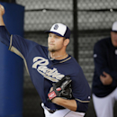San Diego Padres pitcher Josh Johnson throws in the bullpen during spring training baseball practice on Sunday, Feb. 16, 2014, in Peoria, Ariz The Associated Press