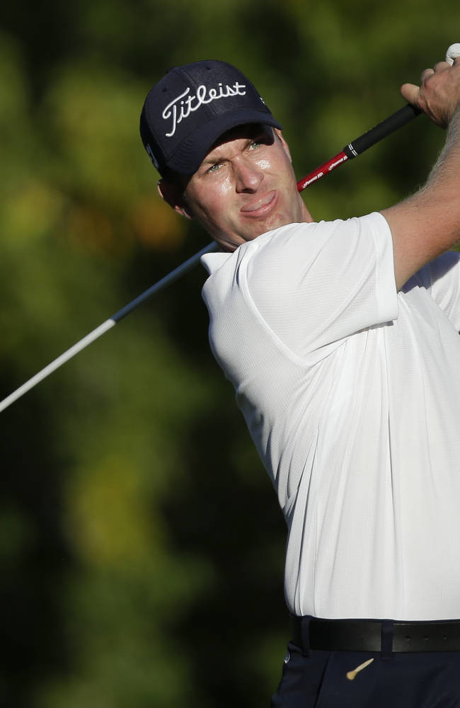 Webb Simpson tees off the 16th hole in the third round of the Shriners Hospitals for Children Open golf tournament, Saturday, Oct. 19, 2013, in Las Vegas