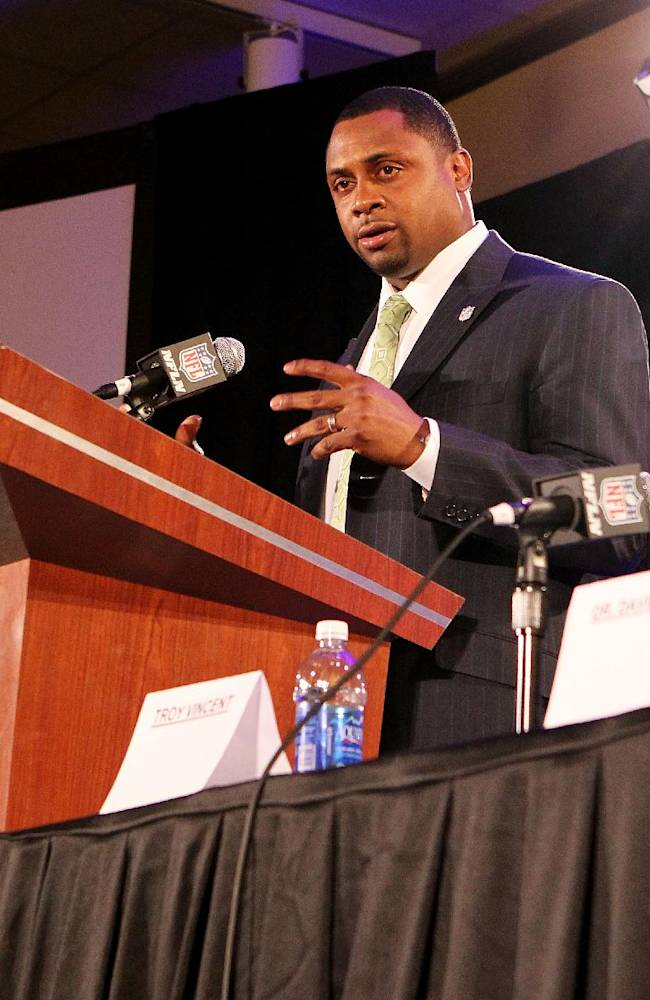 In this file photo taken Jan. 31, 2013, former NFL player Troy Vincent speaks during an NFL Player Health and Safety news conference in New Orleans. Vincent, the new director of football operations, can see in the NFL's future a developmental league, an eighth official on the filed for games, and coaches using tablets on the sidelines to call plays, said in an interview Friday, April 25, 2014. Vincent, president of the players' union, recently replaced Ray Anderson, who left the league to become athletic director at Arizona State