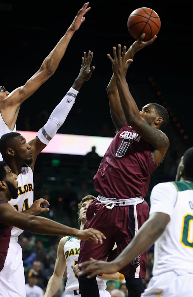 South Carolina's Sindarius Thornwell (0), right, shoots over Cory Jefferson (34) and Issiah Austin (21), left, in the first half of an NCAA college basketball game, Tuesday, Nov. 12, 2013, in Waco, Texas