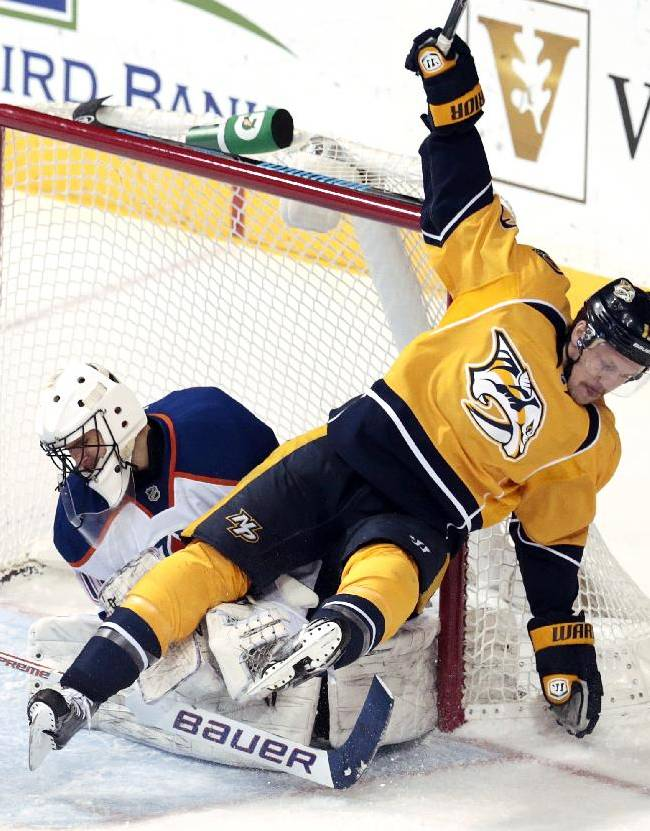 Nashville Predators forward Nick Spaling, right, collides with Edmonton Oilers goalie Ilya Bryzalov, of Russia, in the third period of an NHL hockey game Thursday, Nov. 28, 2013, in Nashville, Tenn