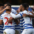 Queens Park Rangers player Eduardo Vargas, second left, celebrates scoring with teammates during their English Premier League soccer match against Liverpool at Loftus Road, London, Sunday, Oct. 19, 2014