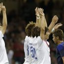 South Korean players celebrate after their teammate Koo Ja-cheol scored, as Japan's Hiroshi Kiyotake walks by during the men's soccer bronze medal match between Japan and South Korea, in Cardiff, Wales, at the 2012 London Summer Olympics, Friday, Aug. 10, 2012. (AP Photo/Luca Bruno)