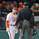 Clemson head coach Jack leggett, left, questions home plate umpire Jack Cox about a call in the fifth inning in an NCAA college baseball game on Friday, March 1, 2013, in Clemson, S.C. (AP Photo/Anderson Independent-Mail, Mark Crammer)