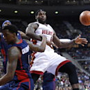 Miami Heat small forward LeBron James (6) is fouled by Detroit Pistons shooting guard Kentavious Caldwell-Pope (5) in the third quarter of an NBA basketball game in Auburn Hills, Mich., Sunday, Dec. 8, 2013 The Associated Press