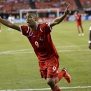Panama's Gabriel Torres celebrates his second goal of the game against Cuba in the first half in the quarterfinals of the CONCACAF Gold Cup soccer tournament, Saturday, July 20, 2013, in Atlanta. (AP Photo/David Goldman)