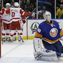Detroit Red Wings center Darren Helm, far left, is congratulated by teammates Justin Abdelkader (8) and Daniel Alfredsson, back, of Sweden, as New York Islanders goalie Kevin Poulin kneels in front of his net after Helm scored a goal during the first peri