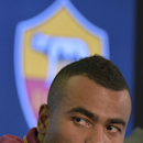 Former Chelsea left back Ashley Cole attends a press conference during the official presentation in Rome Tuesday, July 15, 2014. Cole signed a two-year deal with Roma last week and was presented with the Giallorossi's No. 3 shirt Tuesday. The 33-year-old