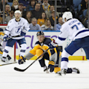 Buffalo Sabres' Zemgus Girgensons (28), of Latvia, reaches to block a pass by Tampa Bay Lightning's Victor Hedman (77), of Sweden, during the second period of an NHL hockey game Tuesday, Dec. 2, 2014, in Buffalo, N.Y The Associated Press