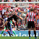Sunderland's Jack Rodwell, center, scores his goal past Manchester United's goalkeeper David De Gea, left, during their English Premier League soccer match at the Stadium of Light, Sunderland, England, Sunday, Aug. 24, 2014