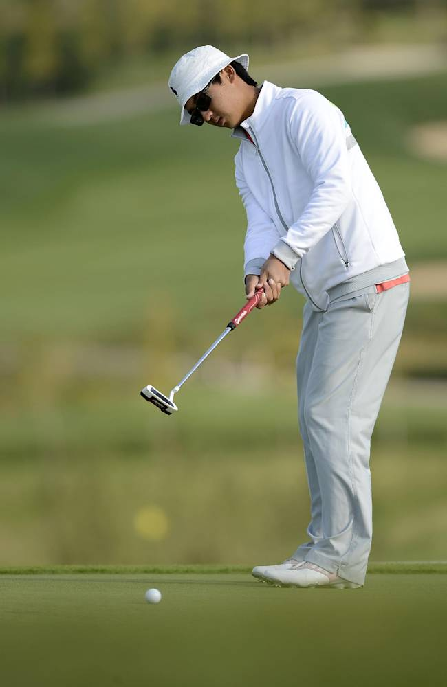 In this photo released by the Asia -Pacific Amateur Championship, Dou Zecheng of China putts during round one of the Asia -Pacific Amateur Championship golf tournament at Nanshan International Golf Club, Garden Course, in Longkou City, China on Thursday, Oct. 24, 2013. (AP Phtoo/Paul Lakatos, AAC) NO LICENSING