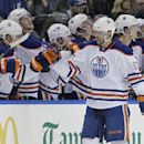 Edmonton Oilers left wing Benoit Pouliot (67) celebrates with the bench after scoring against the Tampa Bay Lightning during the second period of an NHL hockey game Thursday, Jan. 15, 2015, in Tampa, Fla The Associated Press