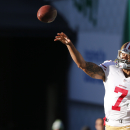 San Francisco 49ers quarterback Colin Kaepernick passes during warmups before an NFL football game against the Seattle Seahawks, Sunday, Dec. 14, 2014, in Seattle The Associated Press