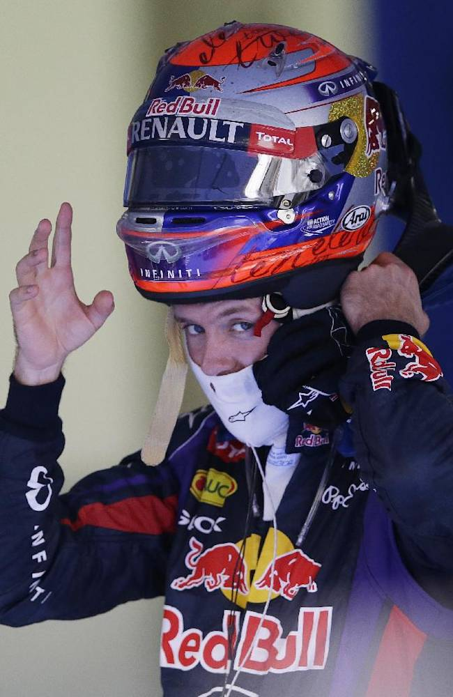Red Bull driver Sebastian Vettel of Germany removes his helmet after winning the Korean Formula One Grand Prix at the Korean International Circuit in Yeongam, South Korea, Sunday, Oct. 6, 2013