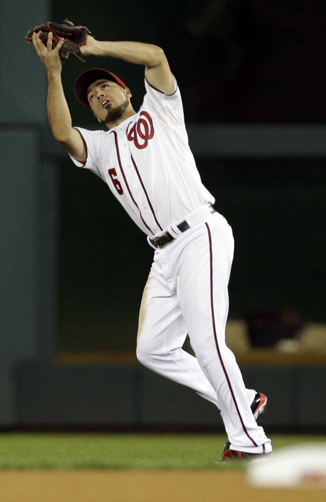 Washington Nationals second baseman Anthony Rendon catches a fly ball against the Miami Marlins during a baseball game at Nationals Park in Washington,  Thursday, Sept. 19, 2013