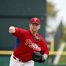 Philadelphia Phillies starting pitcher A.J. Burnett warms up before a spring exhibition baseball game against the Toronto Blue Jays in Clearwater, Fla., Thursday, March 27, 2014 The Associated Press