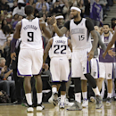 Sacramento Kings center DeMarcus Cousins, right, celebrates with teammate Patrick Patterson during a timeout in the closing moments of an NBA basketball game against the Phoenix Suns in Sacramento, Calif., Tuesday, Nov. 19, 2013. The Kings won 107-104 Th