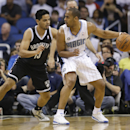 Orlando Magic's Arron Afflalo, right, looks for a way to the basket as he is guarded by Brooklyn Nets' Jorge Gutierrez, left, during the first half of an NBA basketball game in Orlando, Fla., Wednesday, April 9, 2014 The Associated Press
