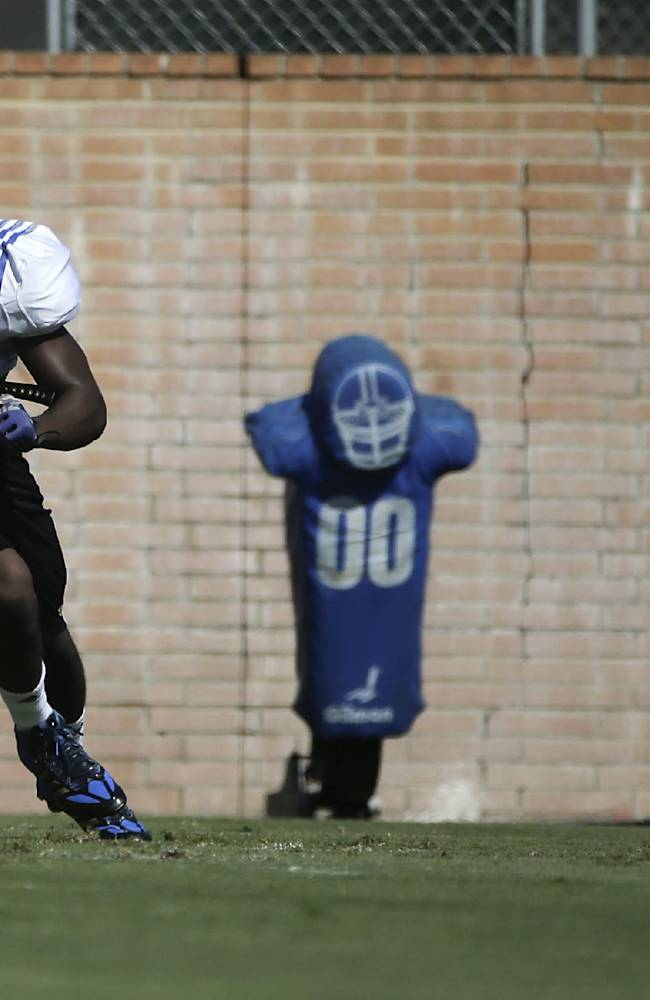 UCLA linebacker Myles Jack runs across the field during NCAA college football practice Wednesday, Aug. 20, 2014, in Los Angeles