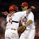 St. Louis Cardinals starting pitcher Adam Wainwright, right, gets a hug from catcher Yadier Molina after throwing a complete baseball game against the Milwaukee Brewers, Wednesday, Sept. 17, 2014, in St. Louis. The Cardinals won 2-0. (AP Photo/Jeff Roberson)