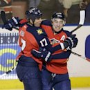 Florida Panthers' Tomas Fleischmann (14) celebrates with Filip Kuba (17) after he scored against the New York Rangers during