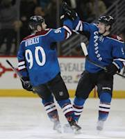 Colorado Avalanche center Ryan O'Reilly, left, celebrates with teammate Matt Duchene after both scored during the shootout against the New Jersey Devils to secure the Avalanche's 2-1 shootout victory in an NHL hockey game in Denver on Thursday, Jan. 16, 2014. (AP Photo/David Zalubowski)