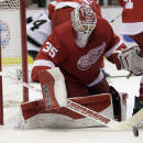 Detroit Red Wings goalie Jimmy Howard (35) makes a save during the third period of an NHL hockey game against the Los Angeles Kings, Friday, Oct. 31, 2014, in Detroit. The Red Wings defeated the Kings 5-2. (AP Photo/Duane Burleson)