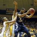BYU forward Brandon Davies (0) pulls down a rebound in front of Southern Mississippi forward Jonathan Mills, left, during the first half of their NIT college basketball tournament game in Hattiesburg, Miss., Wednesday, March 27, 2013. (AP Photo/Rogelio V. Solis)