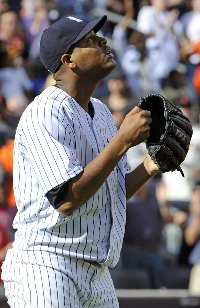 New York Yankees pitcher Ivan Nova reacts after pitching a complete game shutout as the Yankees defeated the San Francisco Giants, 6-0, in an inter-league baseball game Saturday, Sept. 21, 2013, at Yankee Stadium in New York