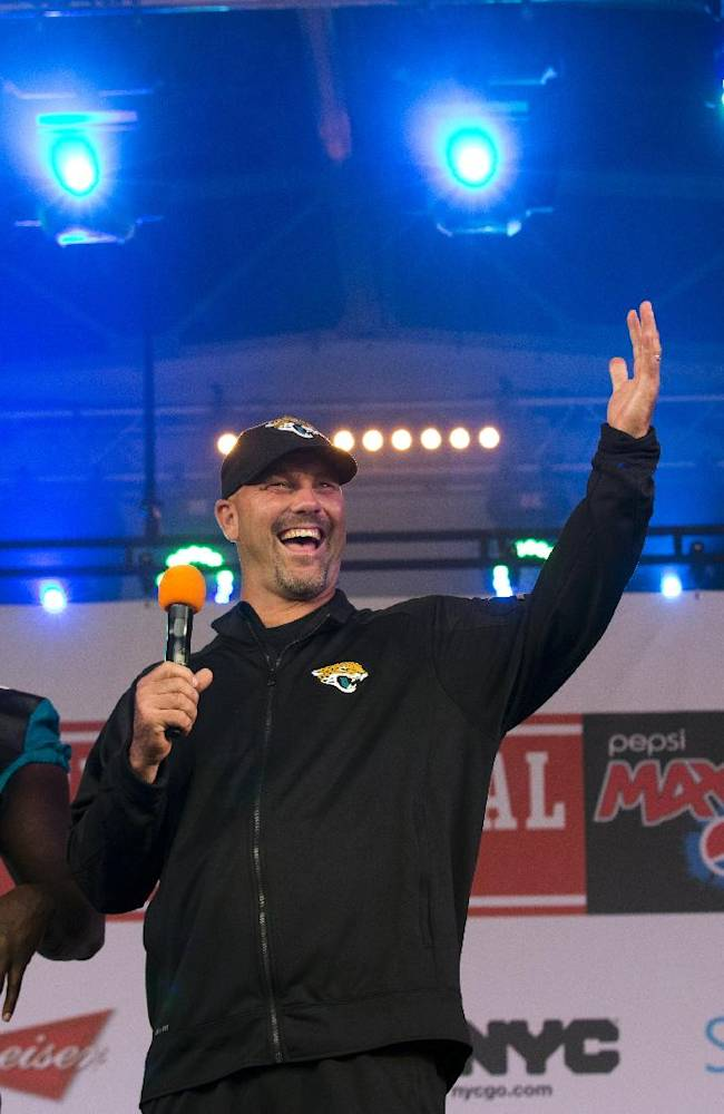 From left, Jacksonville Jaguars' defensive tackle Sen'Derrick Marks, head coach Gus Bradley and placekicker Josh Scobee acknowledge the crowd as they appear on stage during an NFL fan rally in Trafalgar Square, London, Saturday, Oct. 26, 2013.  The San Francisco 49ers are due to play the the Jacksonville Jaguars at Wembley stadium in London on Sunday, Oct. 27 in a regular season NFL game