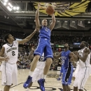 Duke's Mason Plumlee (5) dunks as Wake Forest's Devin Thomas (2) and Travis McKie (30) watch during the first half of an NCAA college basketball game in Winston-Salem, N.C., Wednesday, Jan. 30, 2013. (AP Photo/Chuck Burton)