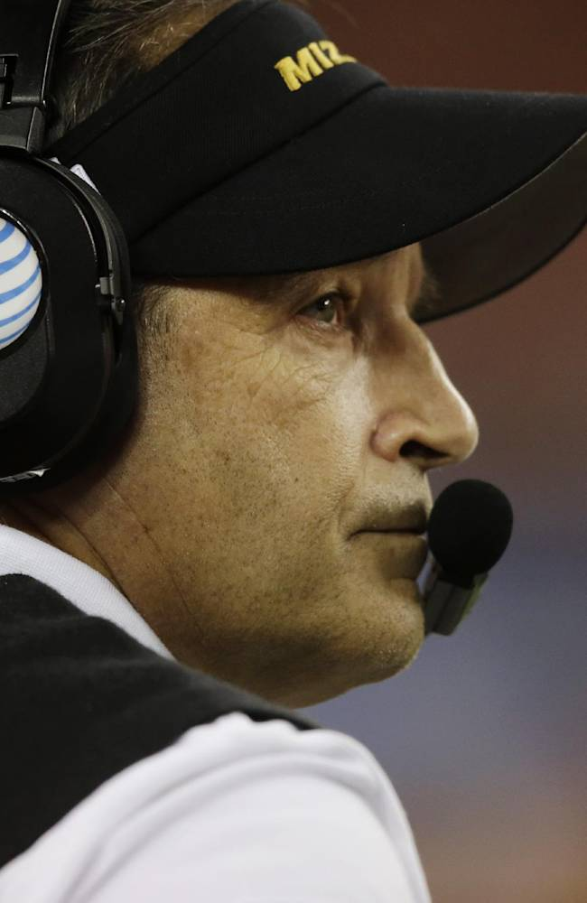 Missouri head coach Gary Pinkel watches the action against Oklahoma State during the second half of the Cotton Bowl NCAA college football game on Friday, Jan. 3, 2014, in Arlington, Texas