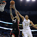 New Orleans Pelicans forward Anthony Davis (23) fouls Miami Heat forward Chris Andersen (11) during the first half of an NBA basketball game in New Orleans, Saturday, March 22, 2014 The Associated Press