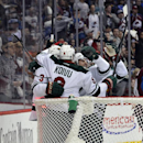 Members of the Minnesota Wild celebrate a goal against the Colorado Avalanche in the first period of Game 2 of an NHL hockey first-round playoff series on Saturday, April 19, 2014, in Denver The Associated Press