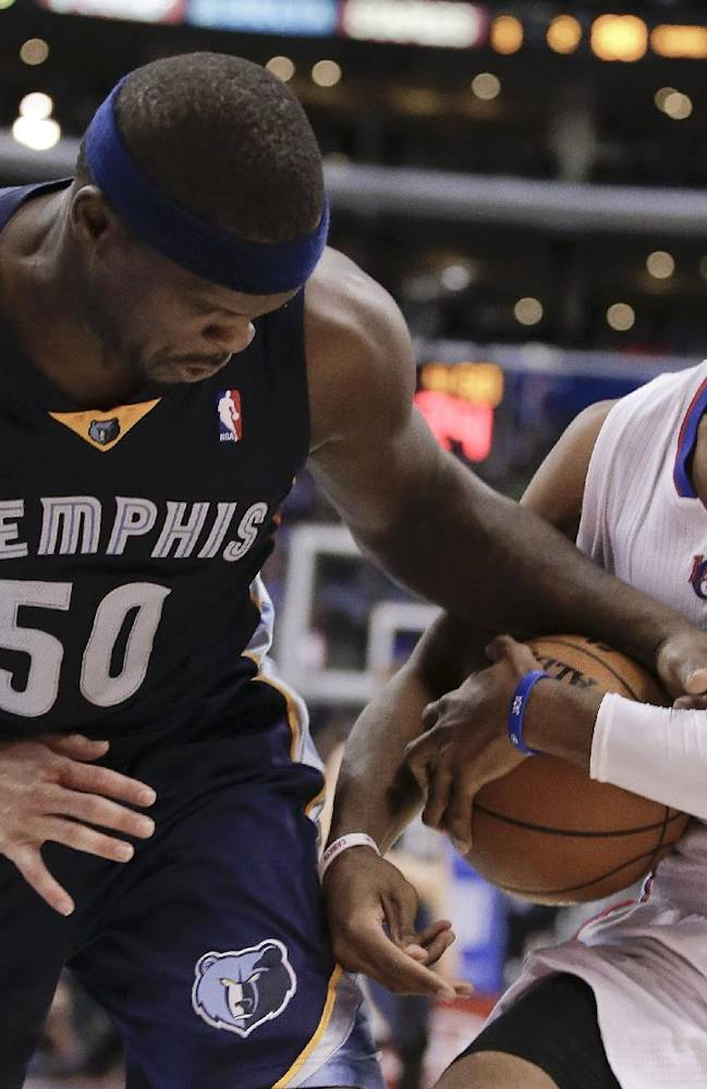 Memphis Grizzlies forward Zach Randolph, left, and Los Angeles Clippers guard Chris Paul battle for a loose ball during the second half of an NBA basketball game in Los Angeles, Monday, Nov. 18, 2013