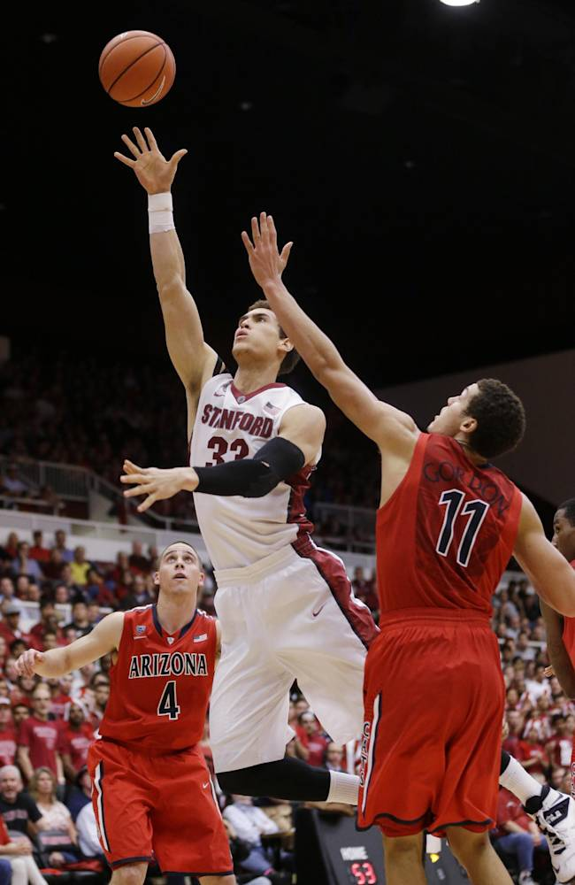 Stanford forward Dwight Powell (33) shoots past Arizona forward Aaron Gordon (11) during the second half of an NCAA college basketball game Wednesday, Jan. 29, 2014, in Stanford, Calif. Arizona won 60-57