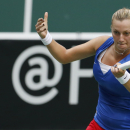 Czech Republic's Petra Kvitova returns a ball to Italy's Roberta Vinci during their Fed Cup semifinal tennis match in Ostrava, Czech Republic, Sunday, April 20, 2014. (AP Photo/Petr David Josek)
