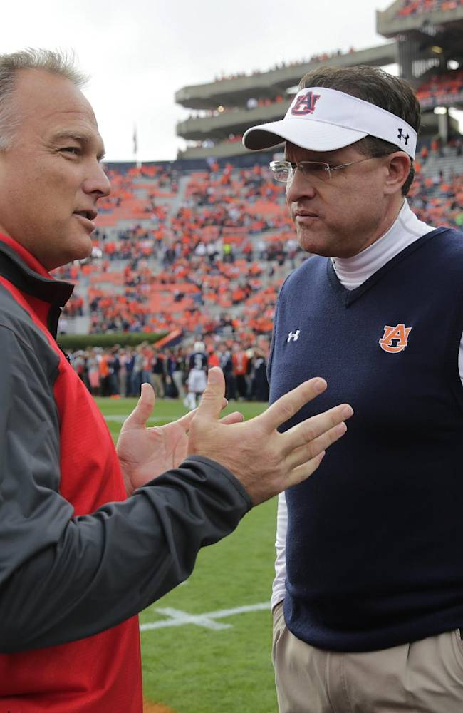 Georgia head coach Mark Richt, left, talks with Auburn head coach Gus Malzahn prior to the start of an NCAA college football game in Auburn, Ala., Saturday, Nov. 16, 2013