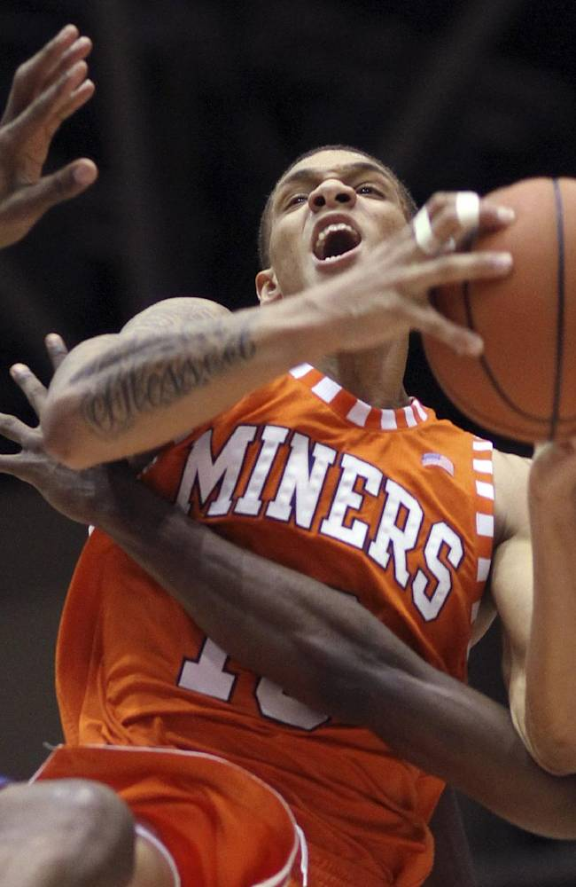In this March 9, 2013, file photo, UTEP's McKenzie Moore (13) is fouled while defended by SMU's Jordan Dickerson, left, and Ryan Manuel, right, during an NCAA college basketball game in Dallas. UTEP said Tuesday, Jan. 7, 2014, it has kicked three players off the men's basketball team after they bet on at least one sporting event. The three players are Moore, Justin Crosgile and Jalen Ragland