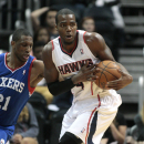 Atlanta Hawks forward Paul Millsap (4) grabs a loose ball against against Philadelphia 76ers forward Thaddeus Young (21) in the second half of an NBA basketball game Monday, March 31, 2014, in Atlanta. Atlanta defeated Philadelphia 103-95. Millsap scored