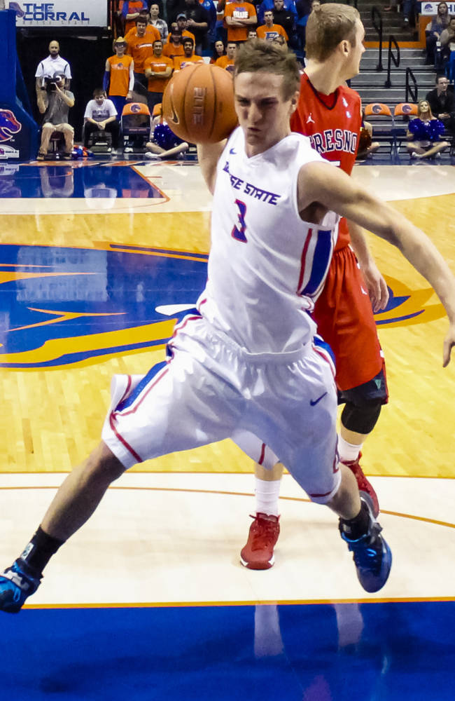 Boise State's Anthony Drmic (3) drives the ball past Fresno State's Cezar Guerrero (3) during the second half of an NCAA college basketball game in Boise, Idaho, on Saturday, Jan. 4, 2014. Boise State defeated Fresno State 86-79