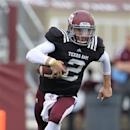Texas A&M quarterback Johnny Manziel (2) scrambles with the ball during the first half of the Aggies' Maroon & White spring NCAA college football game at Kyle Field, Saturday, April 13, 2013, in College Station, Texas. (AP Photo/Houston Chronicle, Karen Warren)
