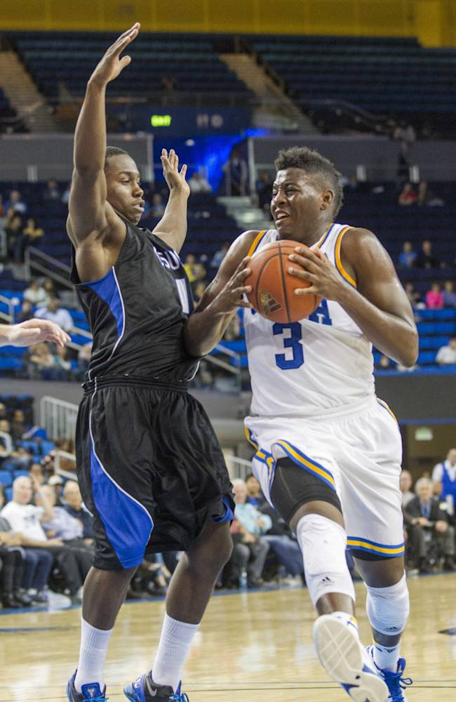 UCLA's Jordan Adams, right, drives against Cal State San Bernardino's Kirby Gardner in the second half of an NCAA college exhibition  basketball game on Wednesday, Oct. 30, 2013, in Los Angeles