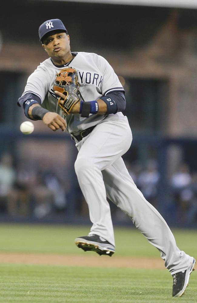 New York Yankees second baseman Robinson Cano makes the difficult throw for the out at first after fielding a deflected grounder by San Diego Padres' Jedd Gyorko in the first inning of an interleague baseball game in San Diego, Friday, Aug. 2, 2013. A runs cpored on the play
