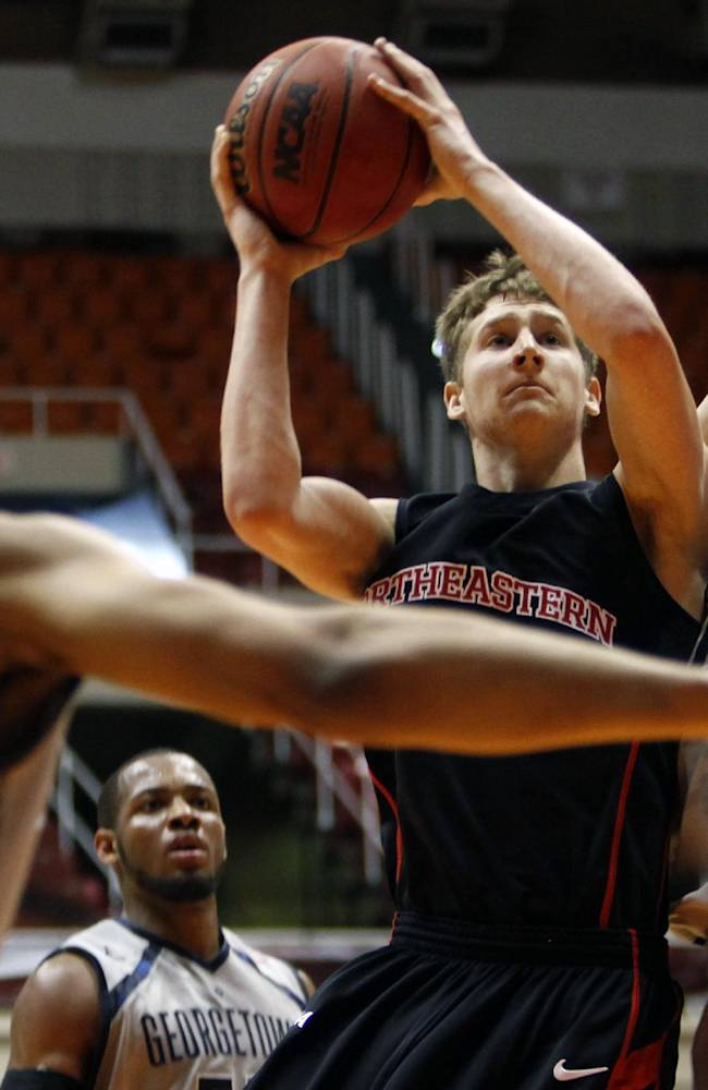 Northeastern guard David Walker shoots against Georgetown players, Markel Starks, left, and Nate Lubick, right, during a NCAA college basketball game in San Juan, Puerto Rico, Thursday, Nov. 21, 2013