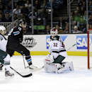Minnesota Wild goalie Niklas Backstrom, right, of Finland, is beaten for a goal on a shot by San Jose Sharks' Joe Pavelski as Sharks center Patrick Marleau (12) and Wild defenseman Jared Spurgeon watch during the first period of an NHL hockey game on Thur