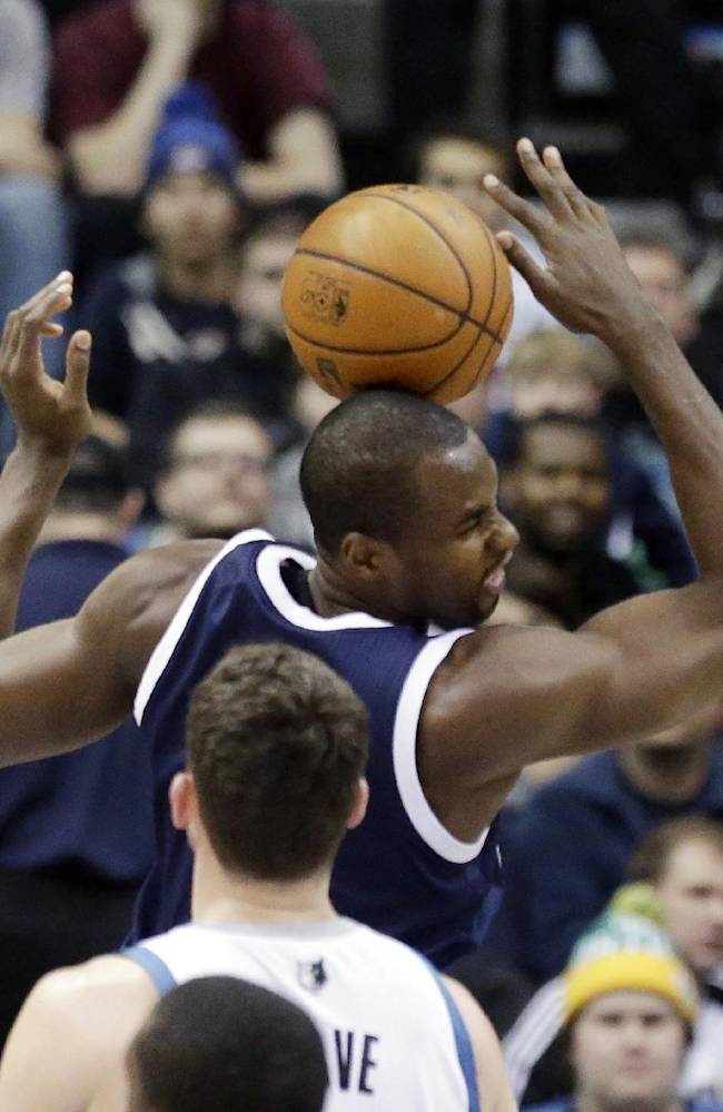 The ball bounces off the head of Oklahoma City Thunder's Serge Ibaka of Congo after his dunk during the first quarter of an NBA basketball game Saturday, Jan. 4, 2014, in Minneapolis. Looking on is Minnesota Timberwolves' Kevin Love