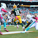 Green Bay Packers wide receiver Randall Cobb (18) grabs a touchdown pass during the second half of an NFL football game as Miami Dolphins outside linebacker Jelani Jenkins (53) and strong safety Jimmy Wilson (27) are late with the tackle, Sunday, Oct. 12